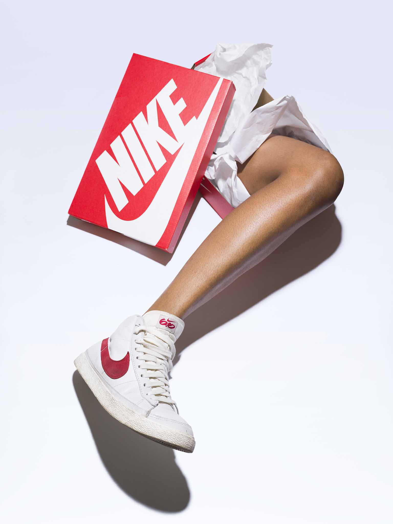 Leg with a white nike sneaker on